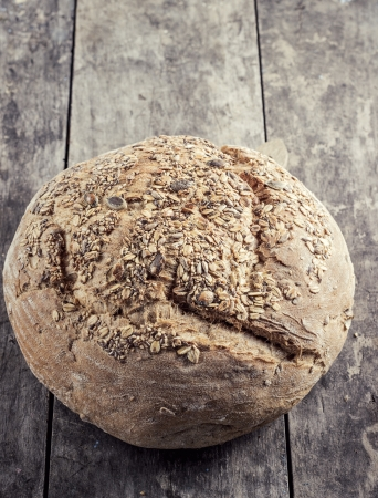 multi grain: Loaf of multi grain farmers bread on table Stock Photo
