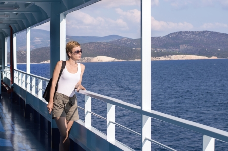 beautiful woman on the deck of the ferry photo