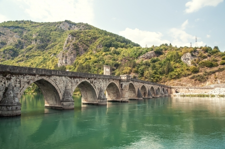 old bridge in Visegrad on Drina river Stock Photo - 21786073