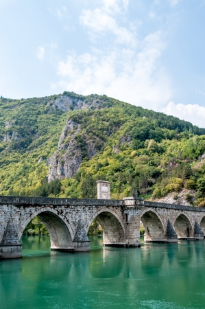 old bridge in Visegrad on Drina river photo