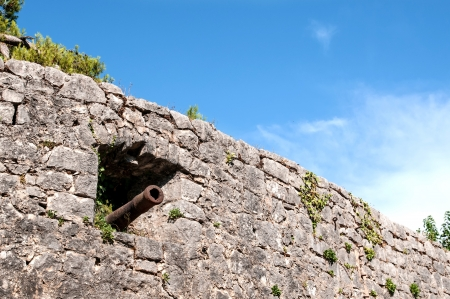 embrasure: Stronghold stone wall with cannon in embrasure
