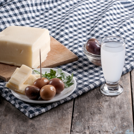 Delicious Cheese and olives on table, close up Stock Photo