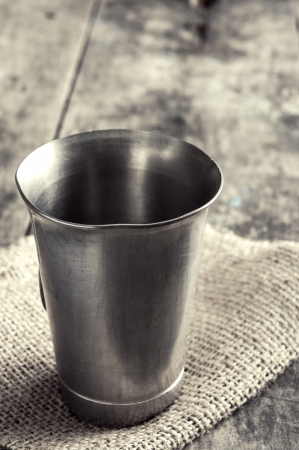 chalices: old metal cup on wooden table, close up Stock Photo