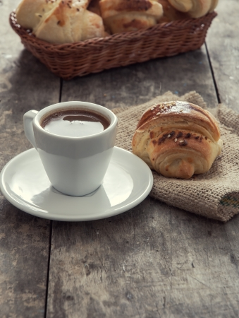 cup of coffee and croissants over wooden background Stock Photo - 22732490