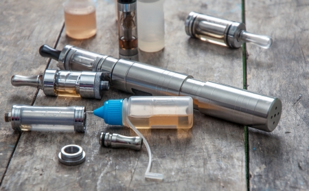 advanced vaping device, e-cigarette on table Stock Photo