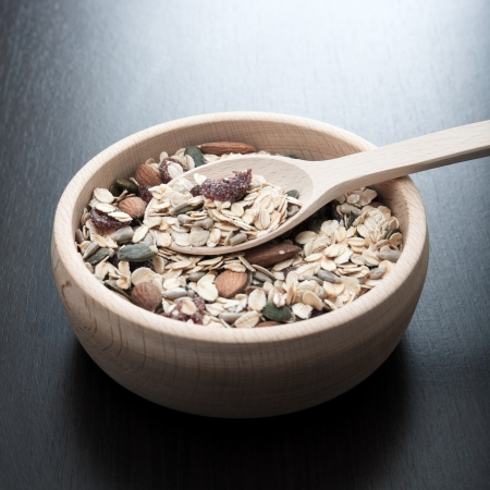 musli: Delicious and healthy cereal in wooden bowl Stock Photo
