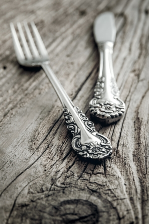 old cutlery on wooden table, close up
