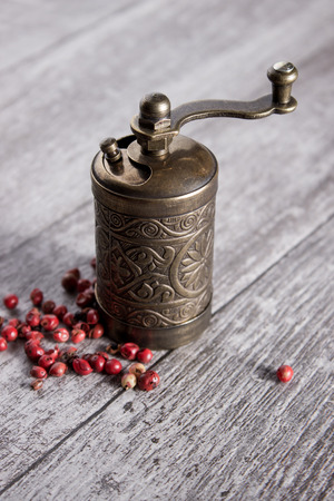 pepper grinder: Old Pepper grinder mill with different dried peppers Stock Photo