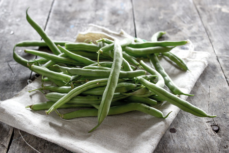 Green Beans on wooden table, natural light Stock Photo - 29608799