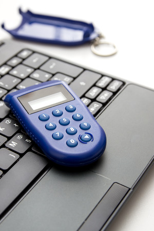 financial controller: One-time password ,e banking. Close up of token on table