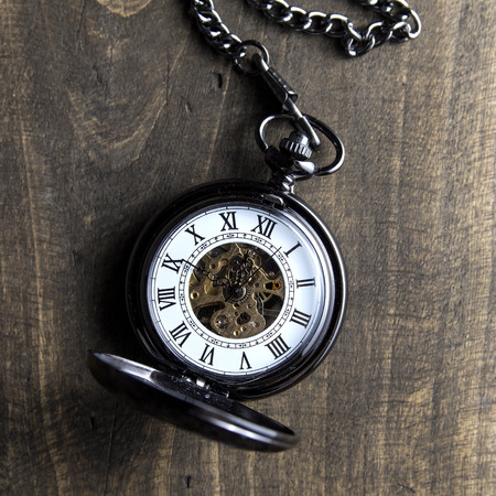cover background time: pocket watch on grunge wooden table, from above