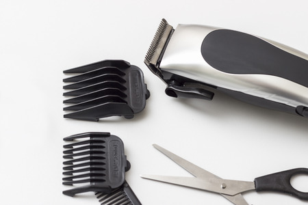 shorten: Barber accessories on white table, close up Stock Photo