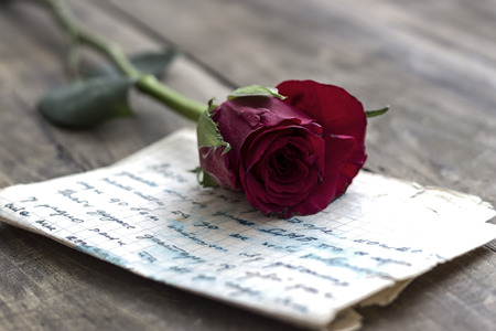 Love letter and rose on wooden background,close up Stock Photo