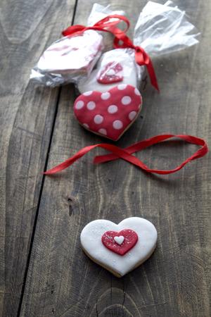 gingerbread heart: Gingerbread heart  on rustic wooden background. Backlit