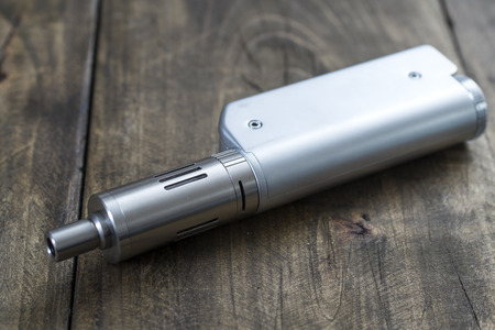 inhalator: Modern electronic cigarette vaporize on the table,  close up