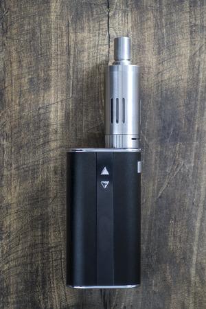 sensory perception: Kit for healthy smoking on wooden background,  e-cigarette