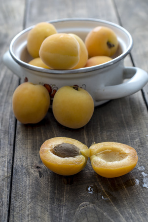freshly: Freshly Picked Apricots on wooden background, close up