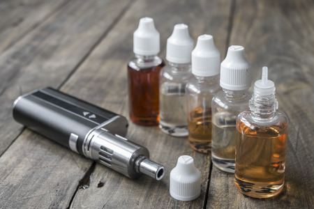 refill: e-cigarettes with different re-fill bottles, close up