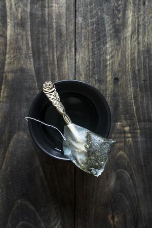 tea bag: close up of a tea bag and a cup of tea, from  above