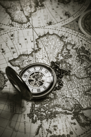 Vintage antique pocket watch on old map background, close up Stock Photo