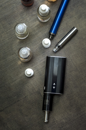refill: e-cigarettes with lots of different re-fill bottles,from above Stock Photo