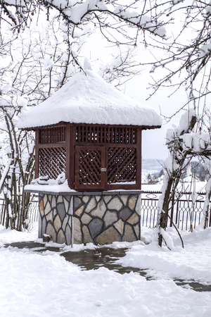 draw well: Draw well in the winter garden. Covered with snow