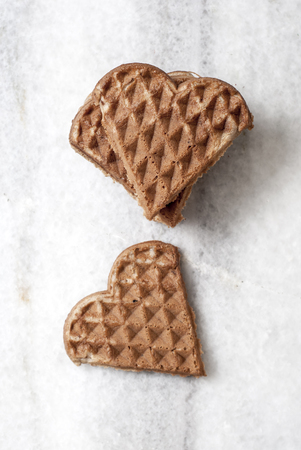 shaped: heart shaped waffles on table, from above