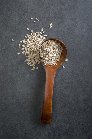 sunflower seed: Sunflower seed with a wooden spoon. From above