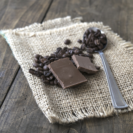 coffee crop: Coffee beans and chocolate on a burlap sack