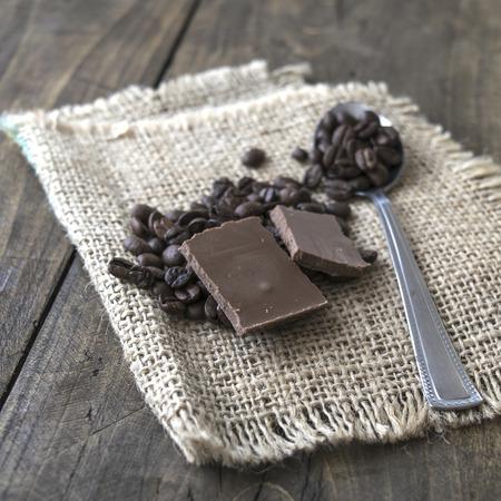 coffee sack: Coffee beans and chocolate on a burlap sack