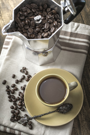 seed pots: Italian coffee  maker pot filled with coffee beans, from above Stock Photo