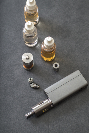 refill: e-cigarettes with lots of different re-fill bottles, from above Stock Photo
