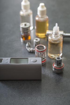 refill: e-cigarettes with lots of different re-fill bottles, close up