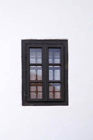 barred: Old barred window on white wall.  Architectural detail.