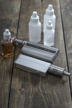 personal decisions: E-cigarettes with lots of different re-fill bottles, close up