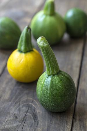 phallic: Fresh zucchini  on wooden table, close up