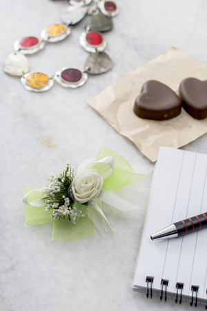 boutonniere: Womens stuff and wedding boutonniere on table Stock Photo
