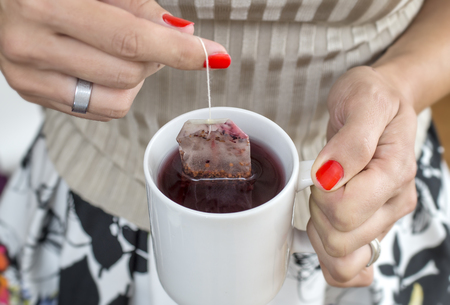 mint tea: Women with a cup of mint tea. Stock Photo