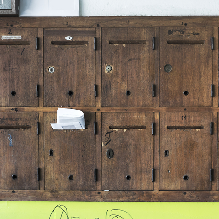Vintage wooden mailboxes in close up