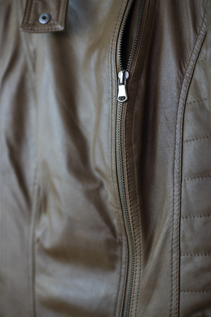 Closeup of a leather texture with a zipper, shallow depth of field
