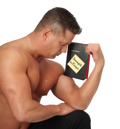 Muscle Man with Bible in Prayer Stock Photo
