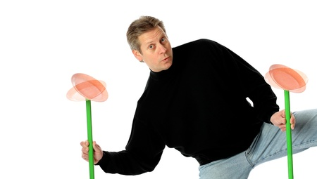 A Man Juggling Spinning Plates on Pole Stock Photo