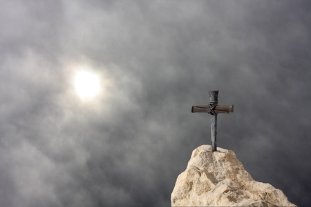 turmoil: Christian Cross on the Rock