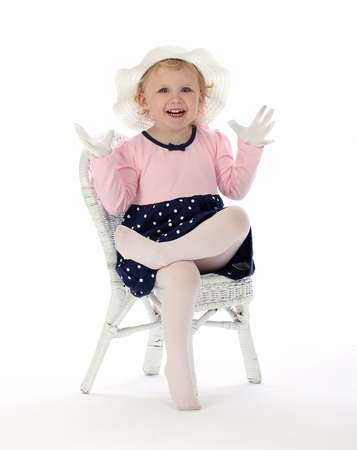 A small girl is happy about a secret surprise on a white background