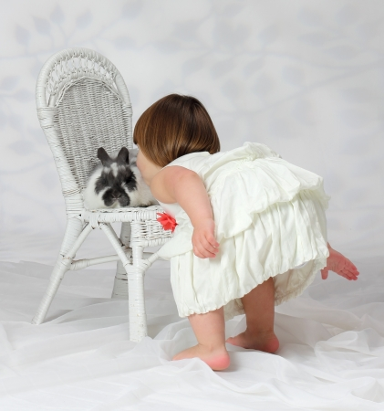 A young girl shows a loving affection to a domesticated animal