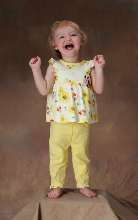 A young girl laughs at a funny joke Stock Photo