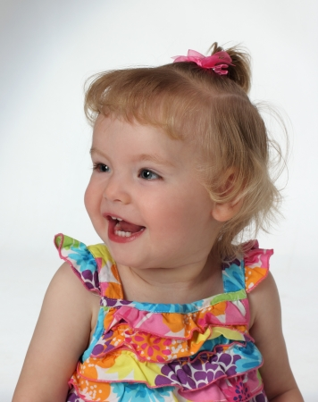 A childl is joyful and shows a big smile and laugh