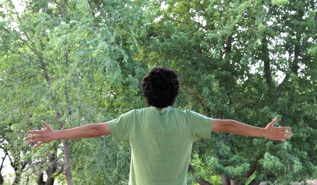 A youth appreciates the wonder of nature in the world