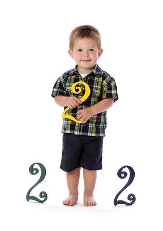 turns of the year: A young boy turns two years old Stock Photo