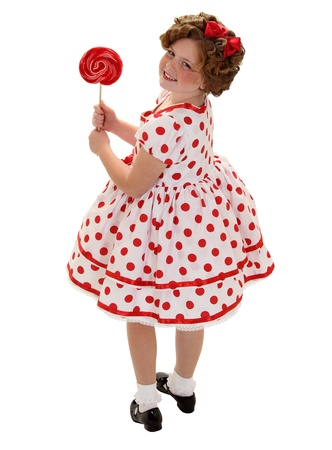 A young girl dressed up to look like Shirley Temple for halloween isolated on white